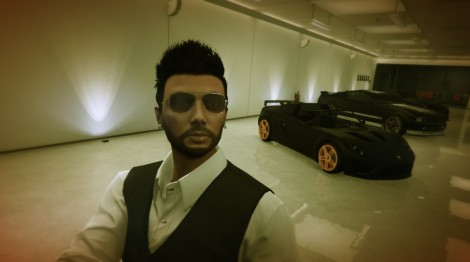 Life in the fast lane: Selfie in my garage with cars I can never afford in two lifetimes